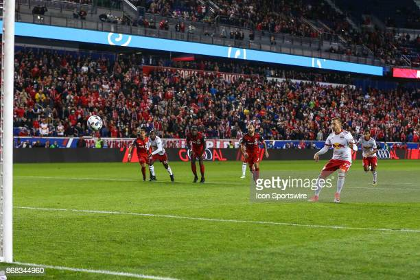 New York Red Bulls midfielder Daniel Royer scores on a penalty kick during the first half of the MLS Cup Playoff game between the New York Red Bulls...