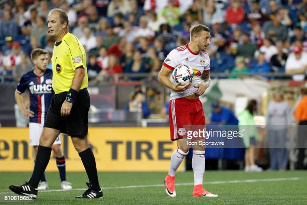 New York Red Bulls midfielder Daniel Royer waits at the penalty spot as referee Silviu Petrescu clears the box during a regular season MLS match...