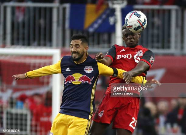 TORONTO ON NOVEMBER 5 New York Red Bulls midfielder Gonzalo Veron and Toronto FC defender Chris Mavinga leap for a header as Toronto FC play the New...
