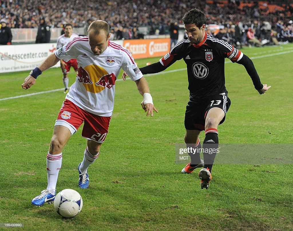 New York Red Bulls midfielder Joel Lindpere (20) works the ball deep in the D.C. United zone against D.C. United midfielder Chris Pontius (13) during first-half action in an MLS Eastern Conference semifinal at RFK Stadium in Washington, D.C., Saturday, November 3, 2012.
