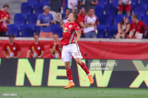 New York Red Bulls midfielder Marc Rzatkowski celebrates after scoring during the second half of the Major League Soccer game between Sporting Kansas...