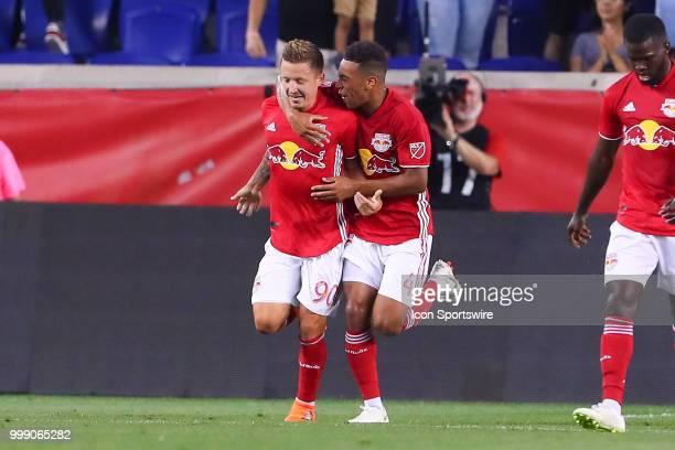 New York Red Bulls midfielder Marc Rzatkowski celebrates with teammate New York Red Bulls midfielder Tyler Adams after scoring during the second half...