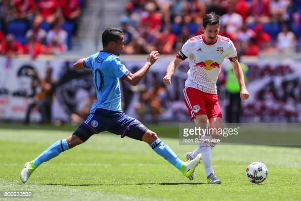 New York Red Bulls midfielder Sacha Kljestan dribbles against New York City FC midfielder Yangel Herrera during the Major League Soccer game between...
