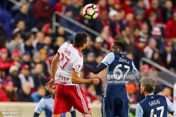 New York Red Bulls midfielder Sean Davis goes up for a headball against Vancouver Whitecaps forward Alphonso Davies during the second half of the...