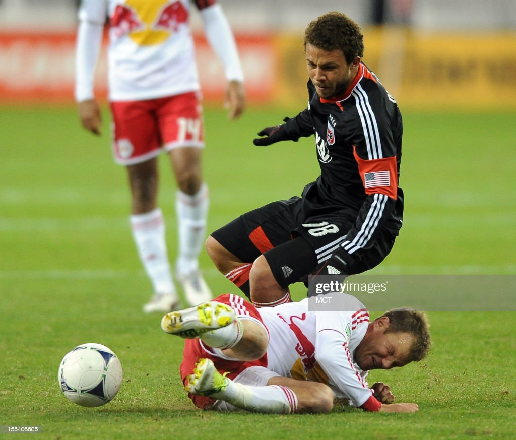 New York Red Bulls midfielder Teemu Tainio (6) takes out D.C. United midfielder Nick DeLeon (18) during second-half action in an MLS Eastern Conference semifinal at RFK Stadium in Washington, D.C., Saturday, November 3, 2012. United and the Red Bulls tied 1-10.