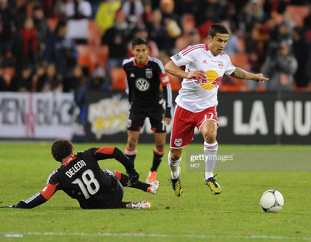 New York Red Bulls midfielder Tim Cahill (17) side steps a challenge by D.C. United midfielder Nick DeLeon (18) during second-half action in an MLS Eastern Conference semifinal at RFK Stadium in Washington, D.C., Saturday, November 3, 2012. United and the Red Bulls tied 1-10.