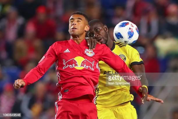 New York Red Bulls midfielder Tyler Adams battles Columbus Crew defender Jonathan Mensah during the second half of the Major League Soccer Eastern...