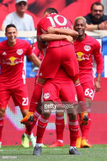 New York Red Bulls midfielder Tyler Adams celebrates with New York Red Bulls midfielder Alejandro Romero Gamarra after a goal during the first half...
