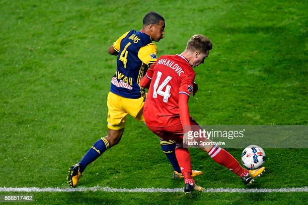 New York Red Bulls midfielder Tyler Adams defends Chicago Fire midfielder Djordje Mihailovic during the MLS Cup Playoff match between the New York...