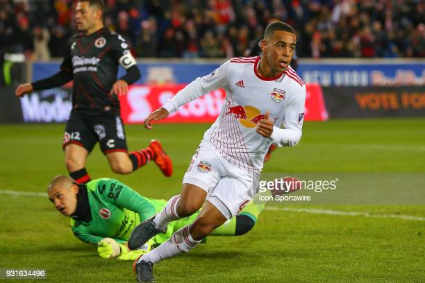 New York Red Bulls midfielder Tyler Adams scores during the first half of the CONCACAF Champions League Quarterfinal match between the New York Red...