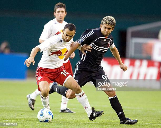 New York Red Bulls' Youri Djorkaeff left battles DC United's Jaime Moreno at RFK Stadium in Washington DC on Sunday April 2 2006 The Red Bulls and DC...