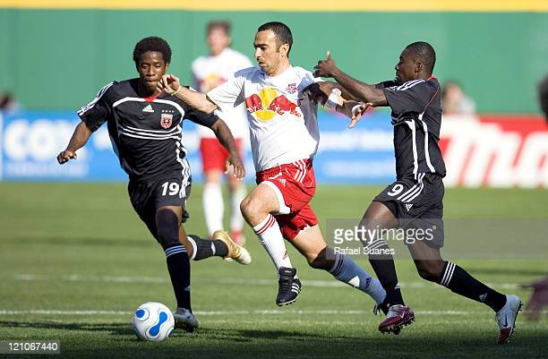 New York Red Bulls' Youri Djorkaeff tries to get past DC United's Clyde Simms right and Freddy Adu at RFK Stadium in Washington DC on Sunday April 2...