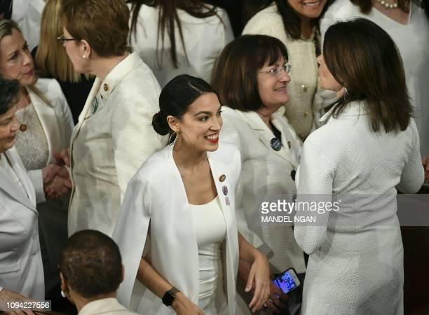 New York Representative Alexandria OctavioCortez is seen amidst other Congress women ahead of US President Donald Trump's State of the Union address...