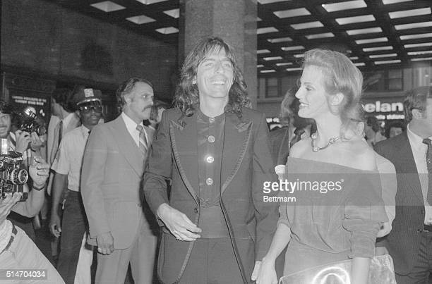 Rock star Alice Cooper and his wife Cheryl arrive at Radio City Music Hall for the gala premiere of the movie Sgt Pepper's Lonely Hearts Club Band...