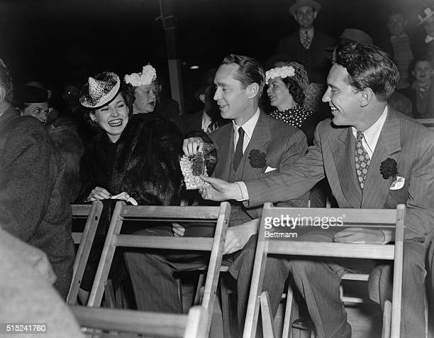 New York: Screen Stage And Radio At Fair. Burgess Meredith, stage star, right and Franchot Tone, of stage and screen, offer some of their popcorn to...