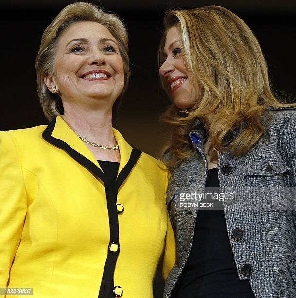 New York Senator and Democratic presidential candidate Hillary Clinton is joined onstage by her daughter Chelsea during a campaign rally in...