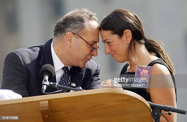 New York Senator Charles Schumer and Nicolle Petrocelli who lost her husband Mark read the names of those killed in the World Trade Towers during a...