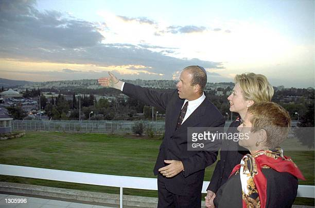New York senator elect Hillary Rodham-Clinton listens to Israeli Knesset Speaker Avraham Burg as they chat on the balcony of Israel''s legislature...