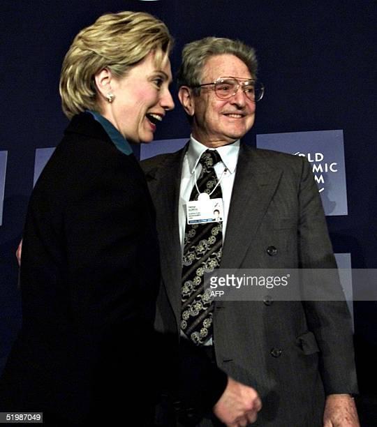 New York Senator Hilary Rodman Clinton greets worldwide investor and philanthropist George Soros at the World Economic Forum in New york 03 Febuary...