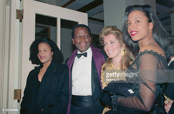 New York: Sidney Poitier and wife, Joanna Simkus, are flanked by daughters Sidney and Anika as Poitier is honored by the American Museum of the...