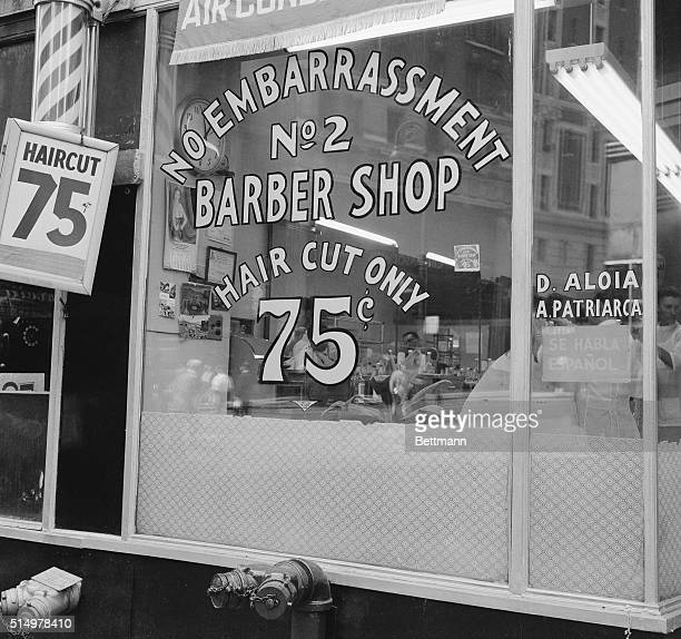 Signs Of Laughter The 'No Embarrassment No 2' barber shop proudly advertises 'hair cut only' for a mere 75 cents Since the shop has no 'extras'...