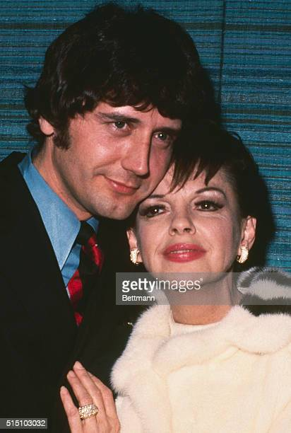 Singeractress Judy Garland gets hugged by husbandtobe Mickey Deans a musician and a manager of a discotheque during a television appearance here They...