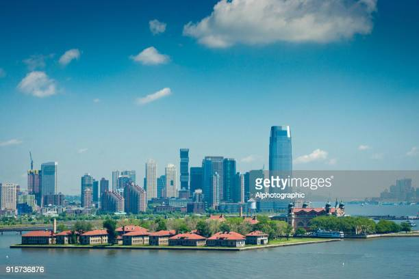 new york skyline and ellis island - hudson bay stock photos and pictures