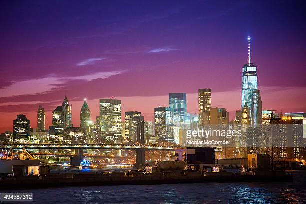 New York skyline at night East River Manhattan bridge