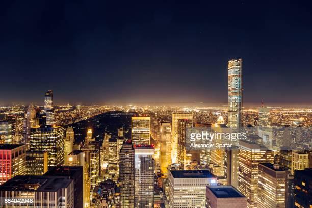 new york skyline at night, ny, usa - central park manhattan stock-fotos und bilder