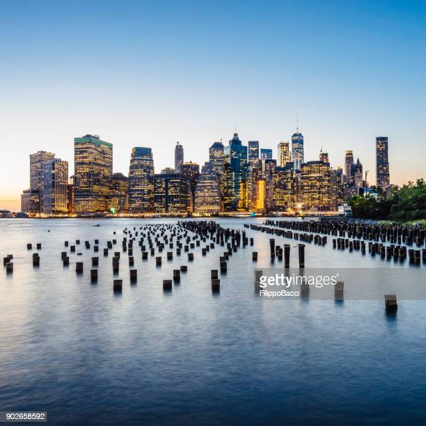 new york skyline at sunset - east stock pictures, royalty-free photos & images
