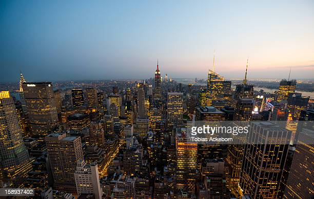 New York Skyline, Manhattan, Summer night, then the Twilight start to show over the Buildings. Taken with wide angel lens. Aerial view.