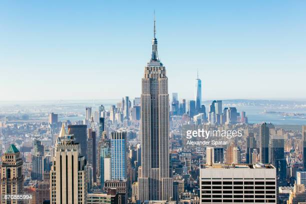new york skyline on a sunny day with clear blue sky - new york skyline stock photos and pictures