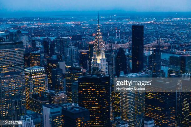 new york skyline through empire state building at dusk - empire state building stock pictures, royalty-free photos & images