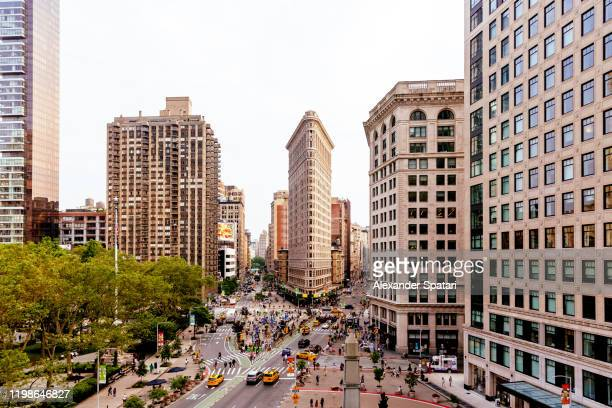 new york skyline with broadway, fifth avenue and flatiron building - broadway manhattan stock pictures, royalty-free photos & images