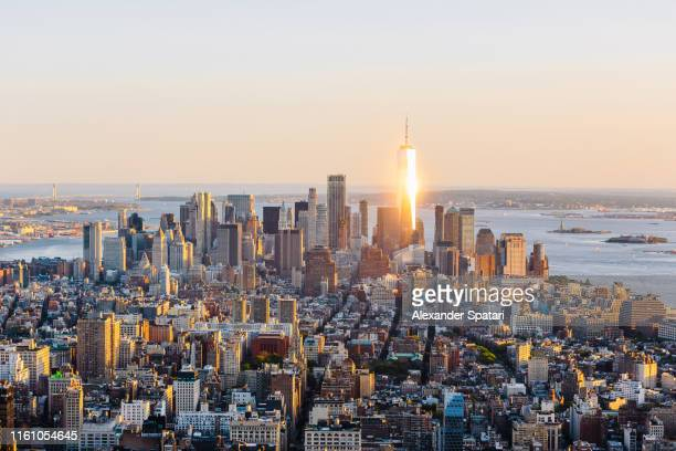new york skyline with manhattan financial district and one world trade center at sunset, ny, usa - world financial center new york city stock pictures, royalty-free photos & images