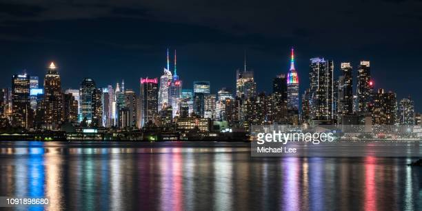 new york skyline with rainbow colors - empire state building stock pictures, royalty-free photos & images