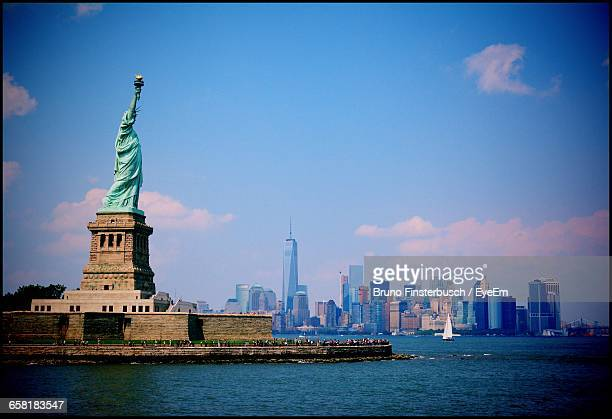 New York Skyline With Statue Of Liberty In Foreground