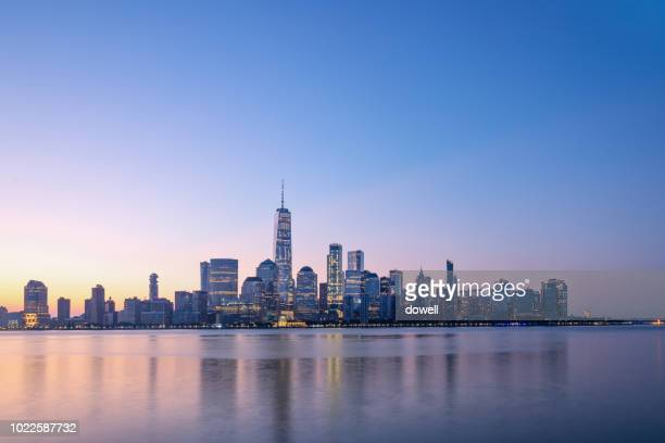 new york skyline with sunrise - new york city stock-fotos und bilder