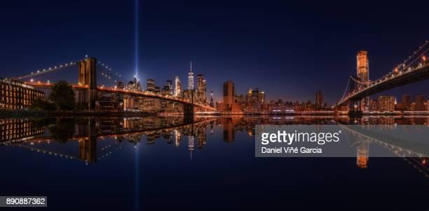 New York Skyline with Tribute in lights, Brooklyn Bridge and Manhattan Bridge at Night