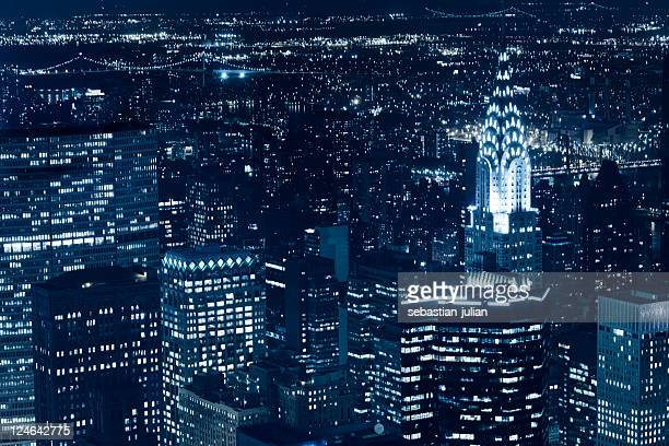 new york skyscraper and chrysler building at night - manhattan new york city stock pictures, royalty-free photos & images