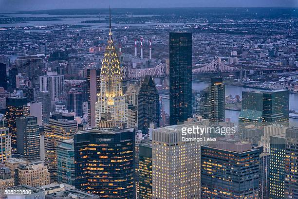 new york skyscraper and chrysler building at night - midtown manhattan stock pictures, royalty-free photos & images