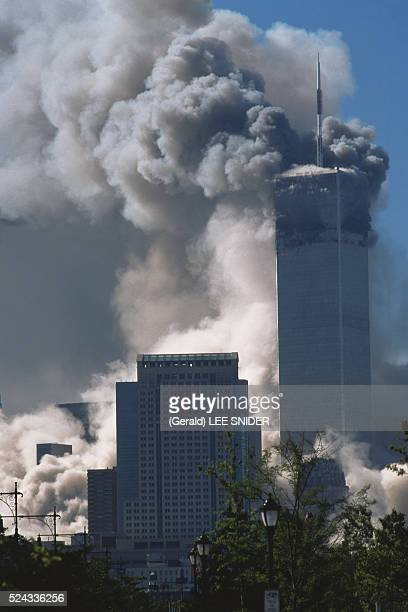 New York: Smoke engulfs neighboring buildings as the South Tower of the World Trade Center collapses, while the North Tower burns, after the...