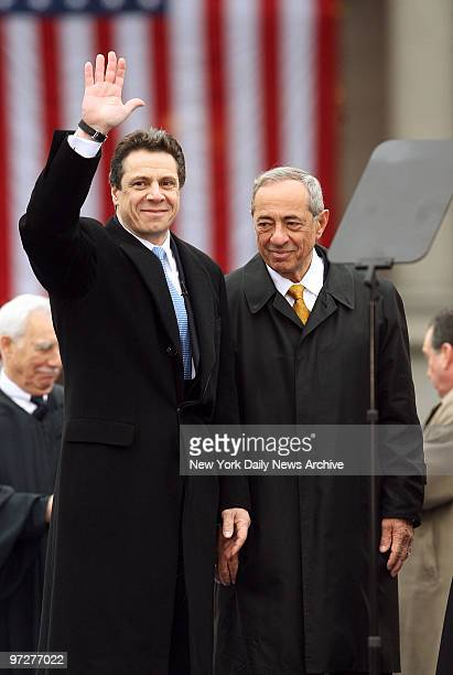 New York State Attorney General Andrew Cuomo is joined by his father Mario as he waves to the crowd after taking the oath of office during inaugural...