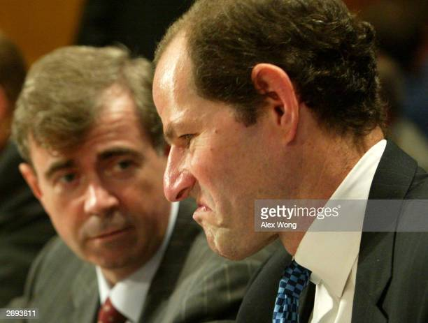 New York State Attorney General Eliot Spitzer reacts as he talks to Secretary of the Commonwealth of Massachusetts William F Galvin prior to a...