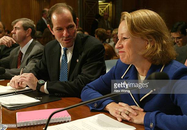 New York State Attorney General Eliot Spitzer talks to National Association of Securities Dealers' Vice Chairman Mary L Schapiro prior to a hearing...