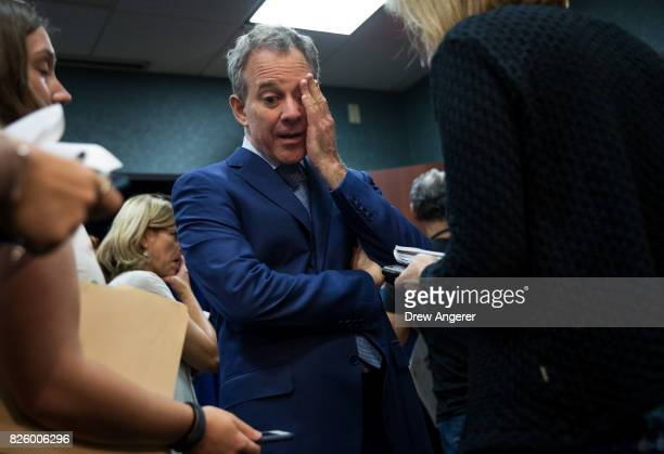 New York State Attorney General Eric Schneiderman pauses while speaking to reporters following a press conference to call for an end of Immigration...