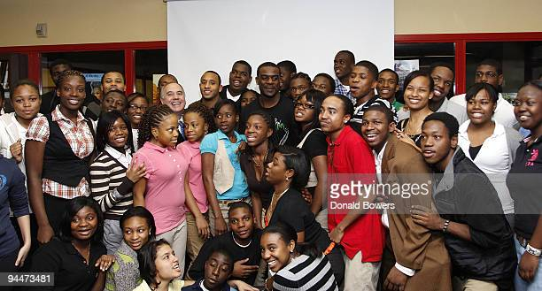 New York State Comptroller Thomas DiNapoli New York Giants Steve Smith and New York Jets Jerricho Cotchery are surrounded by students during VISA's...