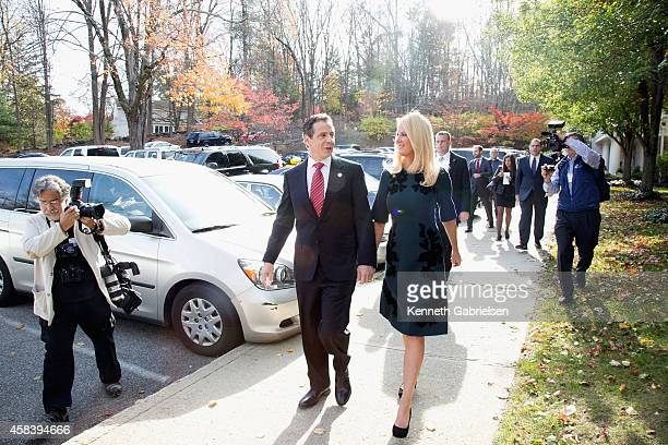 New York State Governor Andrew Cuomo and his girlfriend television personality Sandra Lee arrive to vote during the 2014 general election at the...