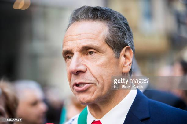 New York State Governor Andrew Cuomo talks with a reporter as he walks in the Columbus Day Parade The parade walked down 5th Avenue in the Manhattan...