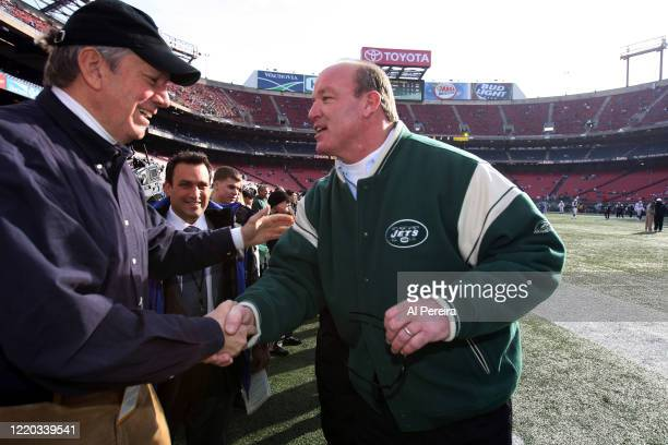 New York State Governor George Pataki speaks with New York Jets alumni player and radio host Marty Lyons when he attends the New York Jets vs the...